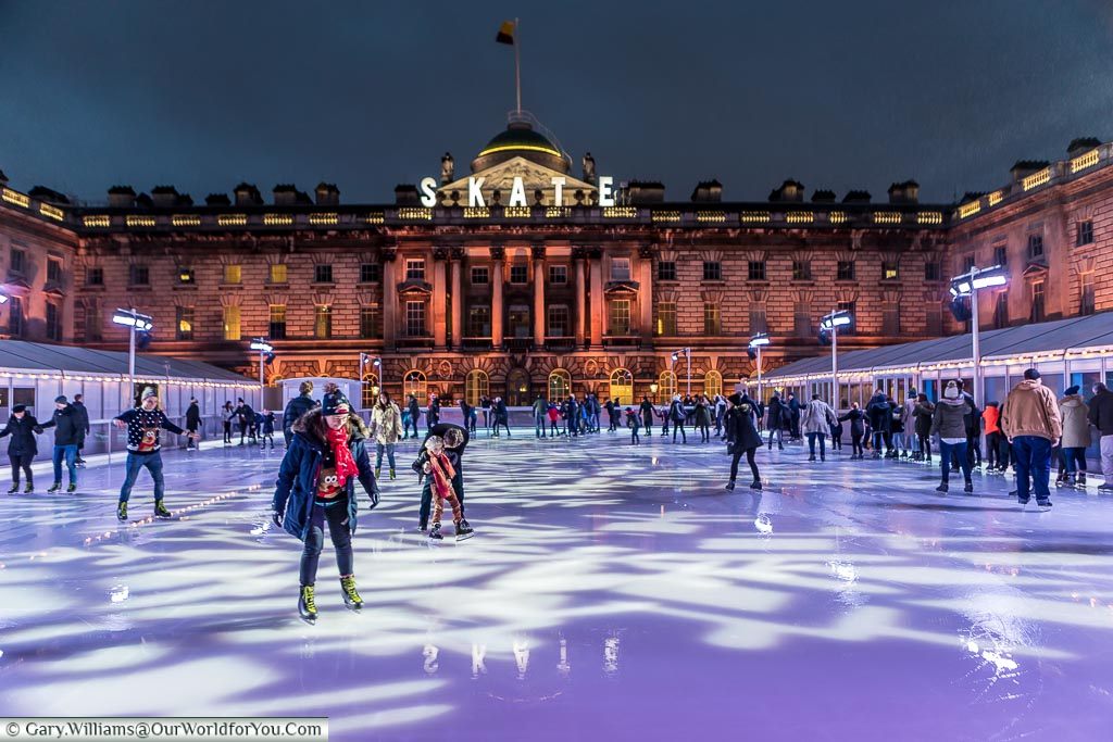 On the ice at Somerset House, Christmas, London, England, UK