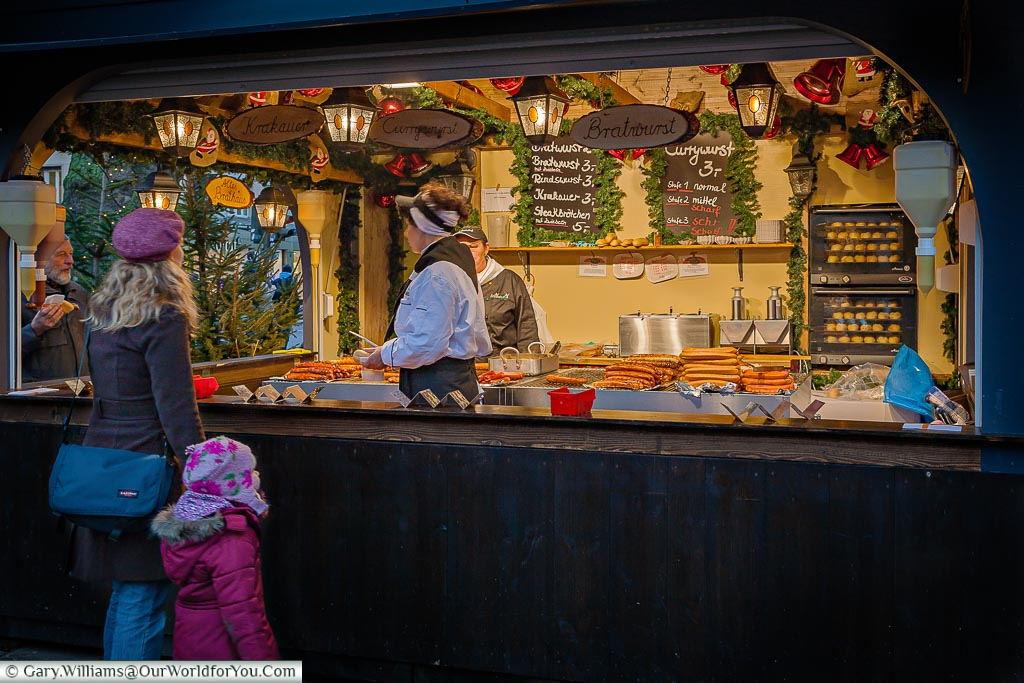 Selecting your sausage at the Angel Christmas Market, Cologne, Germany