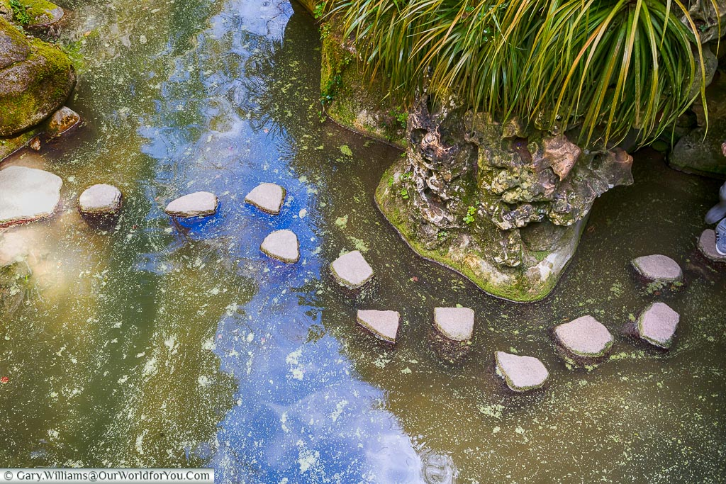 Stepping stones across the Lake of the Waterfall, Quinta da Regaleira, Sintra, Portugal