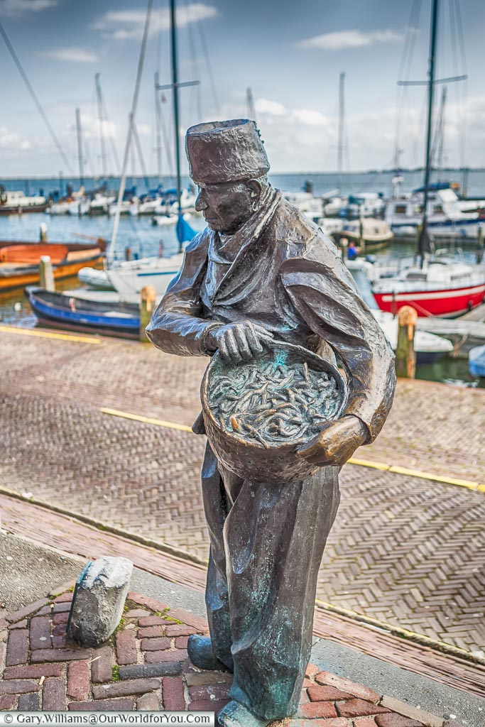 A statue to the trades in Volendam harbour, Holland, Netherlands