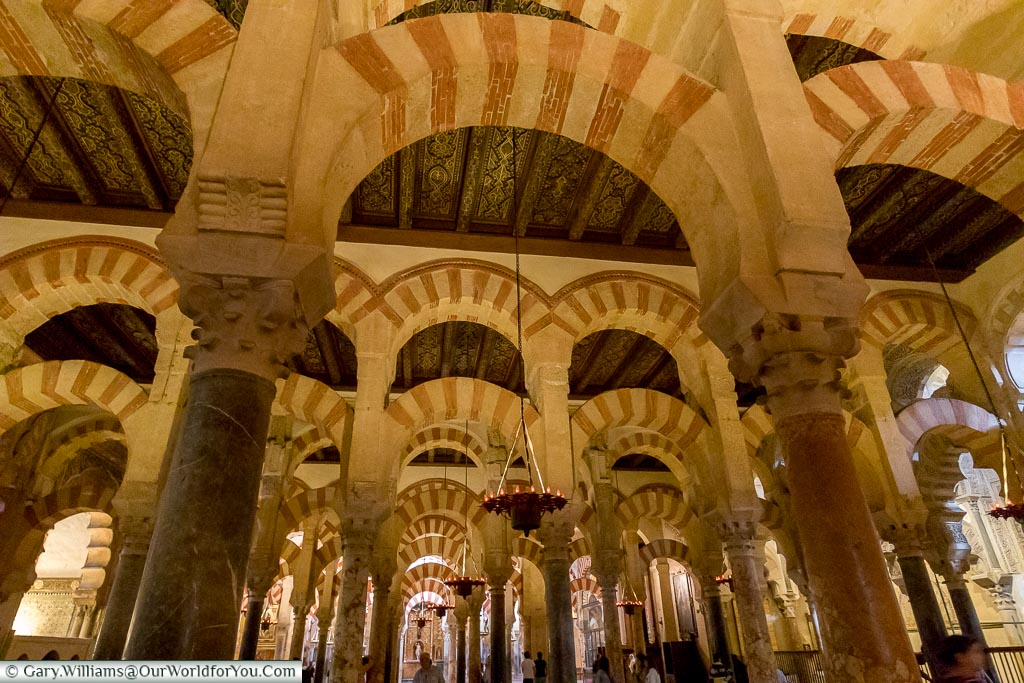 Admire the arches, Mezquita – Mosque–Cathedral, Córdoba, Spain