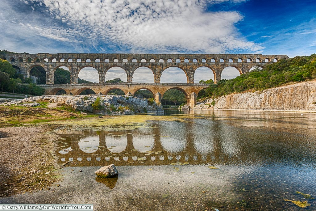 From the river's edge, a fine view of the Pont du Gard, France