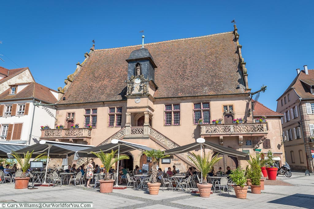 Tables and chairs under parsols outside La Metzig restaurant and bar in the