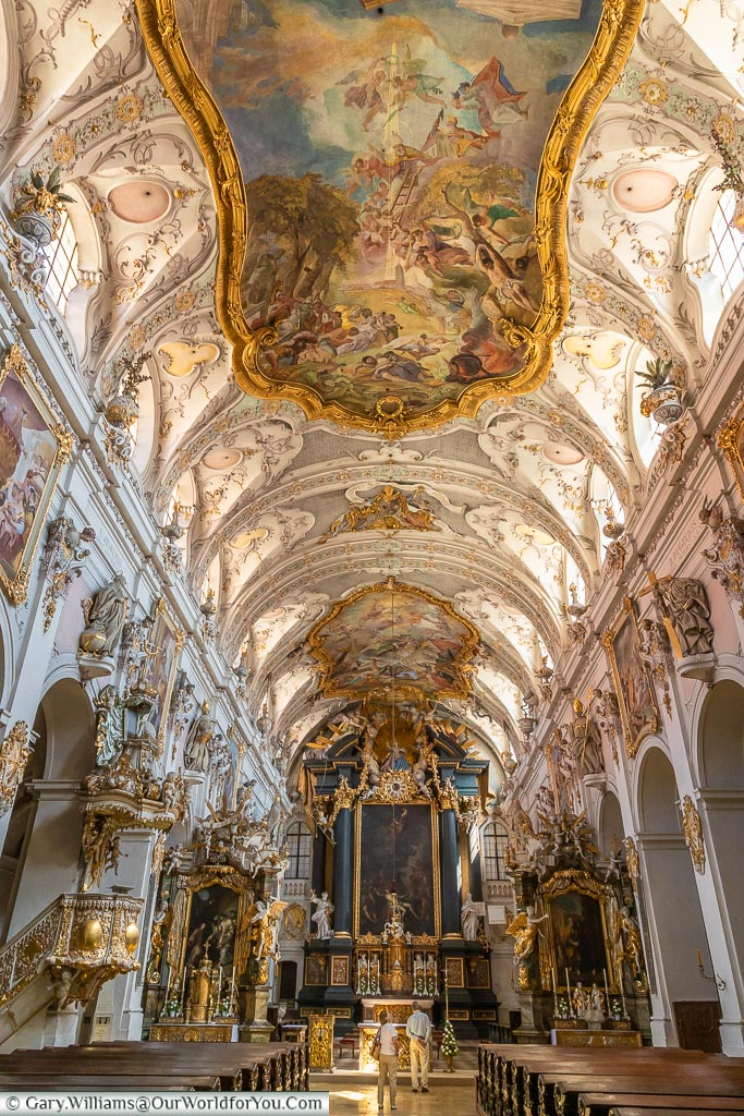 The magnificent view inside St. Emmeram's Abbey in a Rococo style with painted ceilings and richly decorated with gold trimmings.