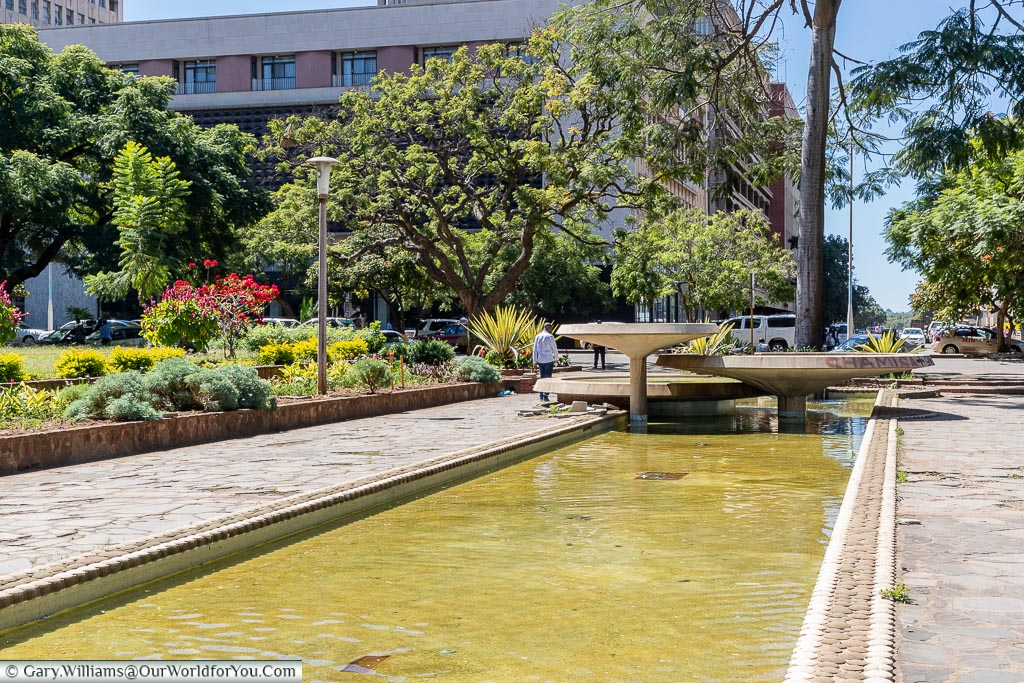A sunken shallow water feature as the centrepiece of Africa Unity Square.