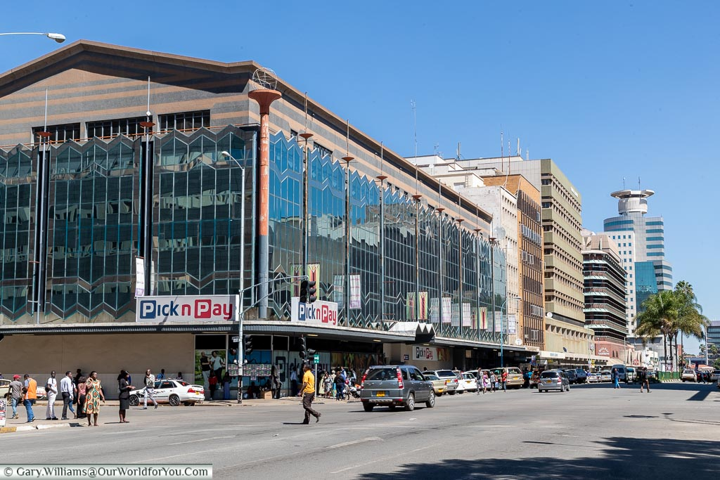 A street scene in downtown Harare that shows a modern, bustling, city centre.