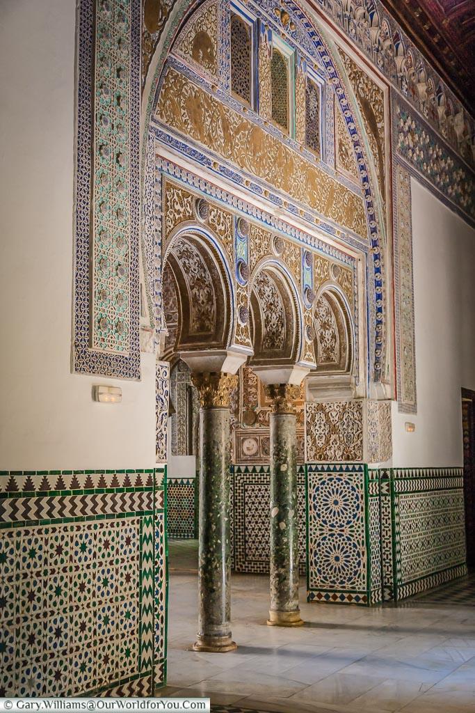 Moorish arches within the Alcazar of Seville.