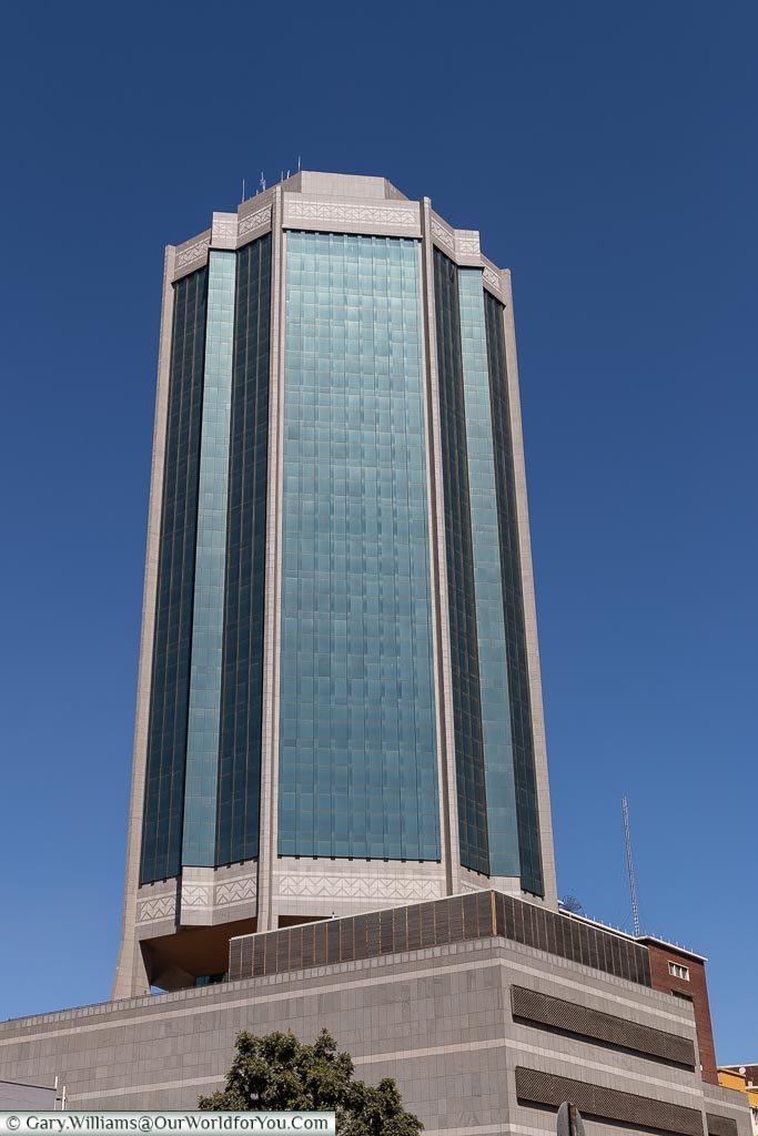 A modern glass tower block of the New Reserve Bank in the centre of Harare.
