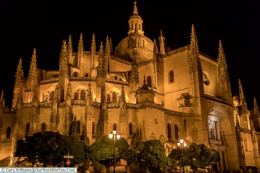 Segovia's cathedral illuminated at night.