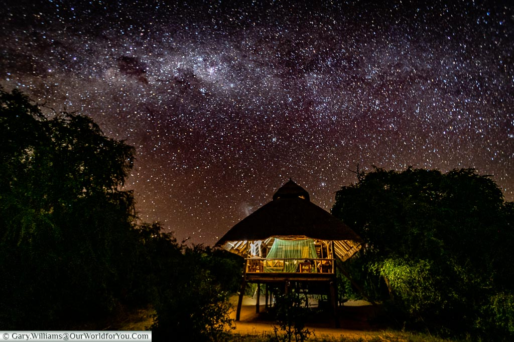 The lodge, under a full African night sky.