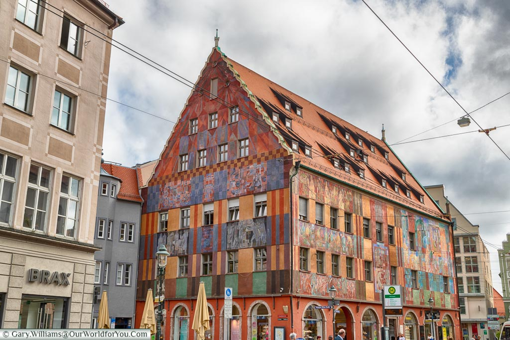 The colourful Weavers House decorated with murals on the outside, now home to shops.