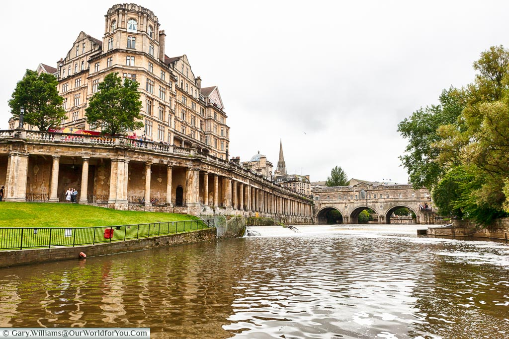 The view of the Pulteney Weir at Bath in front of the Pulteney Bridge as we attempt to turn the 65 foot (20m) Widebeam canal boat around.