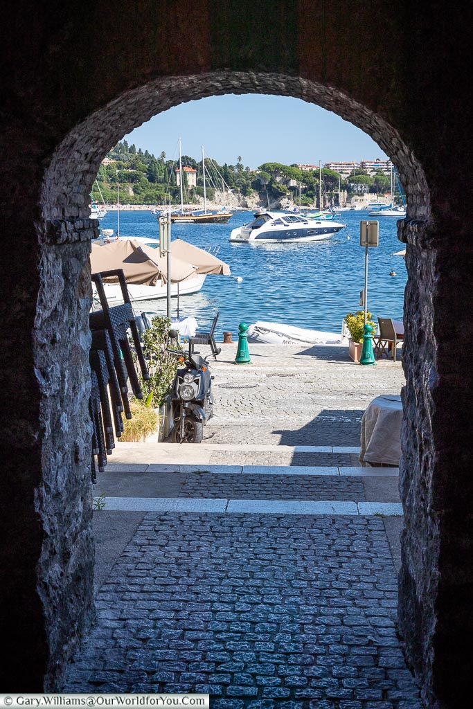 Looking through an arch to the bay of Villefranche-sur-Mer.