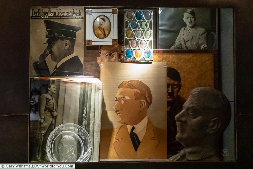 A collection of images, photos and a bust of Adolf Hitler.