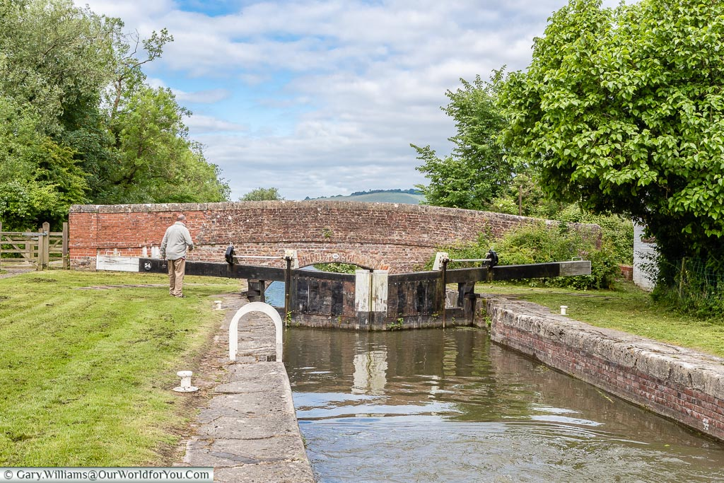 A full lock is now level with the bridge over the waterway on its exit.  Demonstrating the height you can climb on some of the sections of the Kennet and Avon Canal