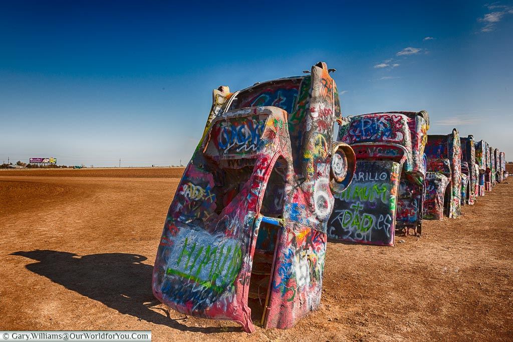All the cars lined up at the Cadillac Ranch