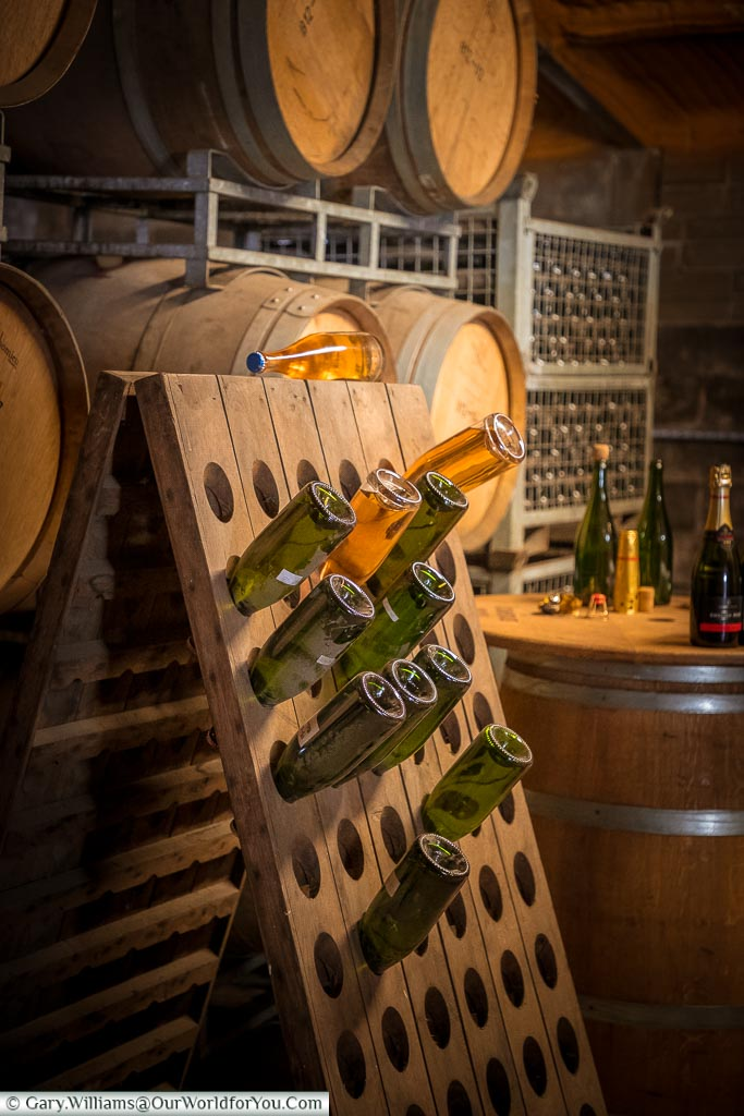 A riddling rack, a wooden A-frame, designed to hold wine bottles angled upside down to persuade the sediment to travel towards the neck of the bottle.