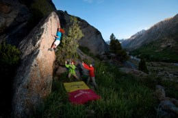 The team tries some of the great bouldering in the area.