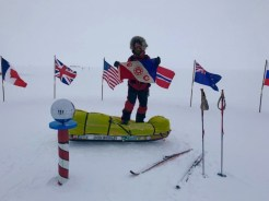 Colin holds the Explorers Club Flag as he reaches the Ceremonial South Pole on December 12, 2018.