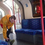 Stretching at the end of a run on the London Underground