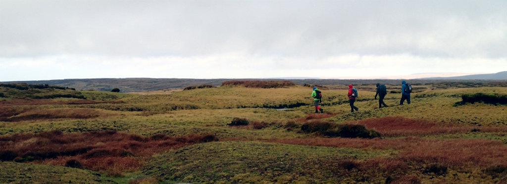 Solo bacpacking is not for everyone - a group of walkers navigate in the Peak District