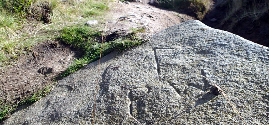 Pennine Way improvised marking engraved on a rock