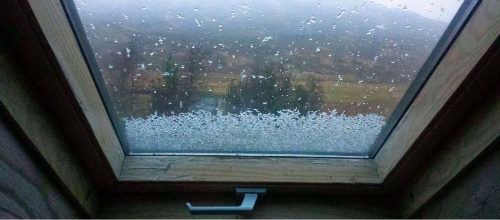 Snow piling on the roof window in Maol Bhuidhe