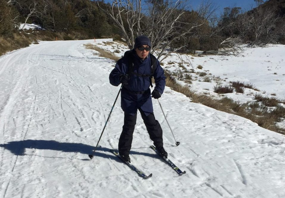Out Doors Inc participant, Gary Wong, skiing on a program