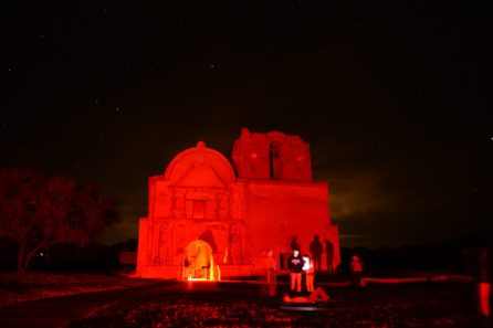 Mission bathed in red lights during meteor viewing Tumacacori