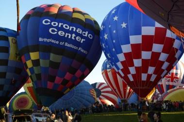 Sun peaks thrugh the balloons
