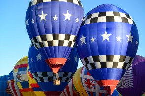 These three balloons and balloonists were really fast, showing off their skill in the flag drop exercises