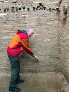 Scoping out the plaster that once lined the whole wall
