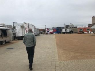 Bruce strolls along the food truck lot