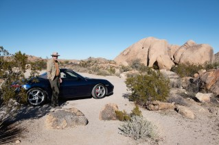 Bruce stands by our 'other' car which is much harder to drive on dirt roads!