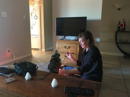 No tree, no problem - Megan decorates the tiny tree that has history as a dorm room tree and an RV tree