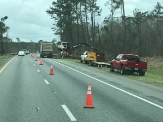 Trees are cleaned up after October's Hurricane Michael damage on I-10