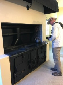 Bruce checks out the stove at Plum Orchard