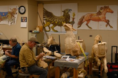 Carvers work on carousel animals