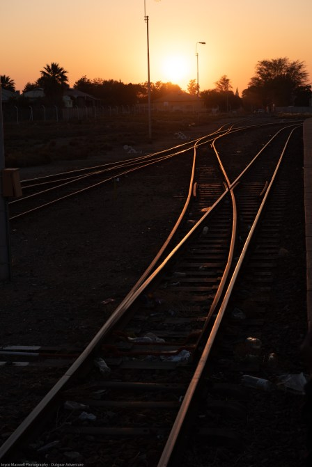 Rails lit up by the rising sun