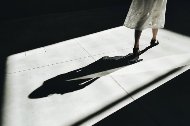 A woman's shadow considering therapy