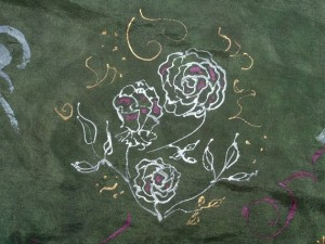 I dyed a white silk scarf green, then drew the silver rose plant and gold accents with silver and gold resist.