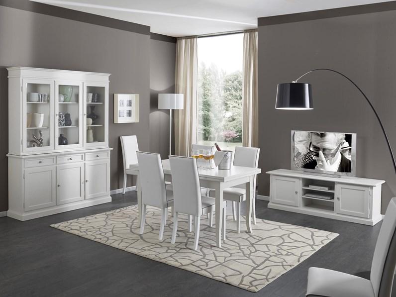 Soggiorno in legno bianco con tavolo sedie mobile tv e credenza