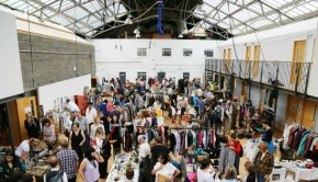 A busy crowd browses wares at an Edinburgh Flea Market event.