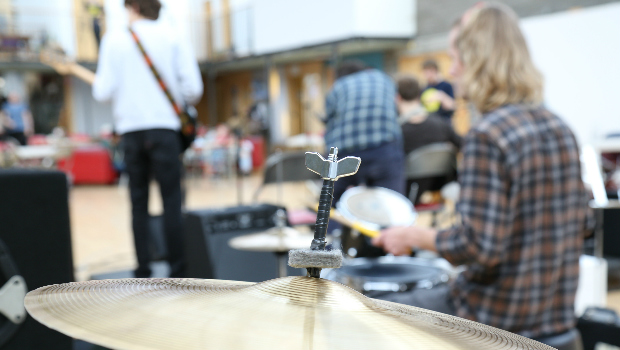 Drummers, singers and guitarists play a Bruncheon event at the Out of the Blue Drill Hall