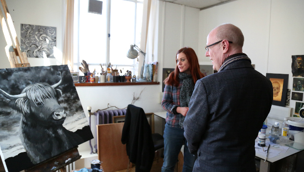 Artist at Leith Walk Studios meets a Scottish Government minister to discuss art produced in Edinburgh.
