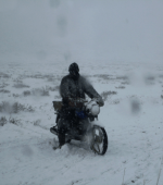 Mongolia nomad motorcycle snow