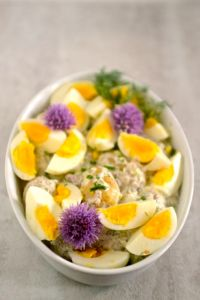 Potato and Egg Salad in Dish with Chive Blossoms