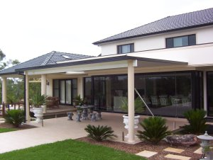 Flat roofed metal awning using insulated roof panels