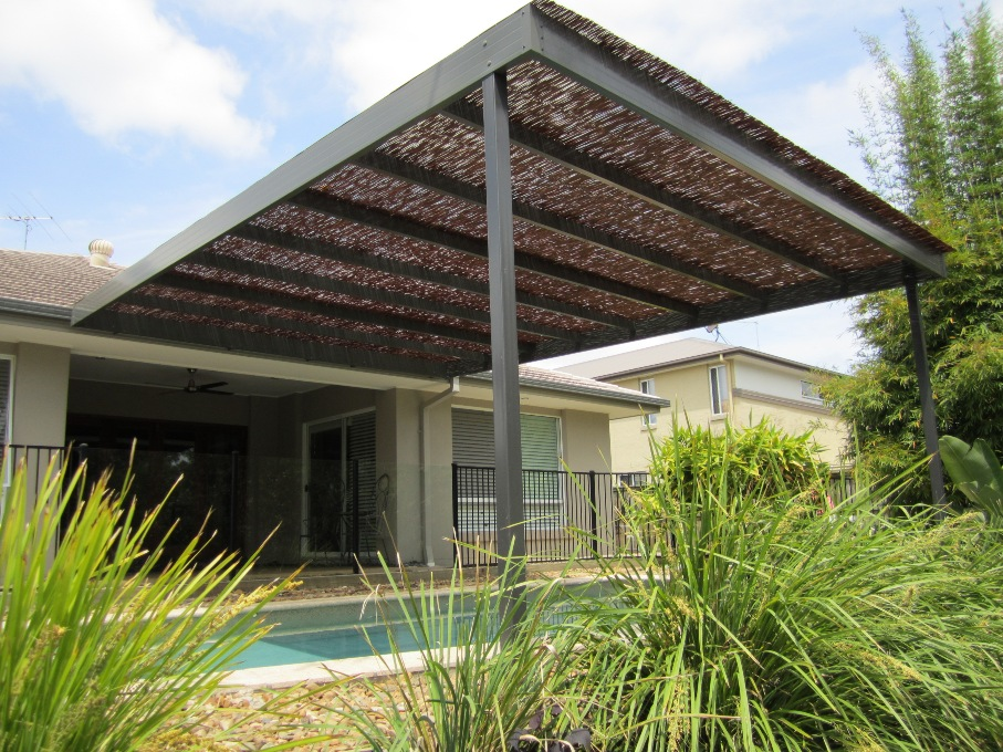 A Queensland Patio Over Pool With A Bamboo Roof For