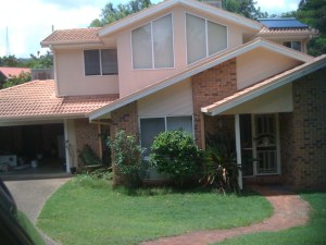 Before: Two storey brick and concrete tiled house in Brisbane